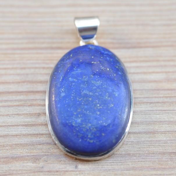 Gros cabochon ovale en lapis lazuli serti d'argent